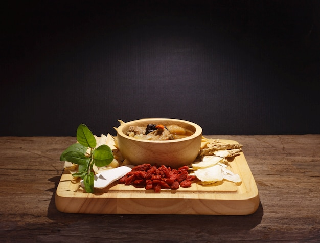 Bowl of chinese soup against black