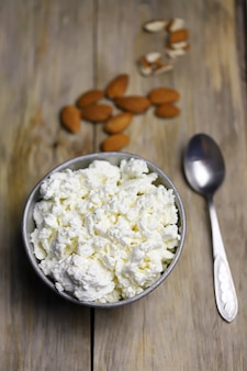 A bowl of cottage cheese and almonds