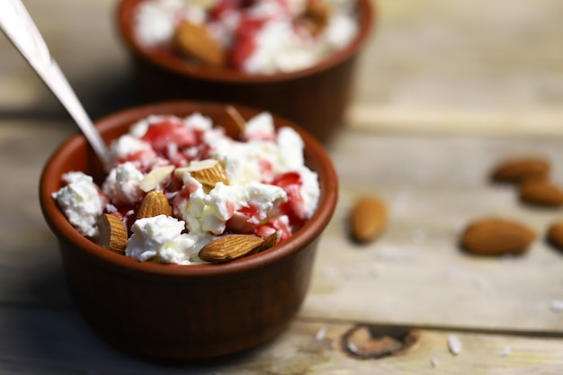 A bowl of cottage cheese with topping and almonds