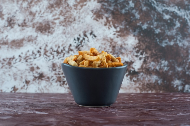 A bowl of crispy breadcrumbs on the marble surface
