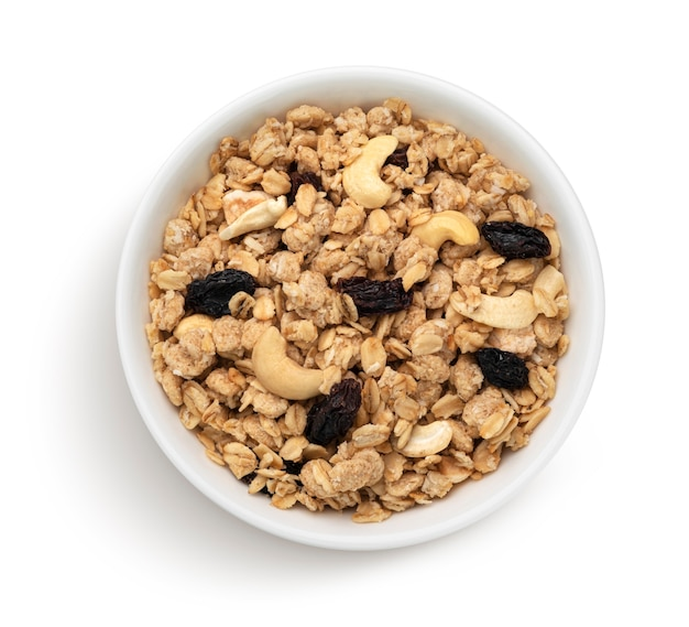 Bowl of crunchy muesli with nuts isolated on white background