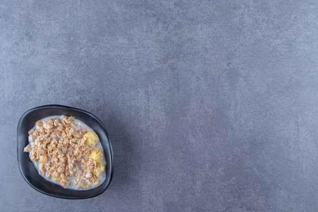 A bowl of delicious muesli, on the blue background. high quality photo