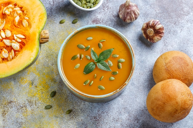 Bowl of delicious pumpkin soup with seeds.