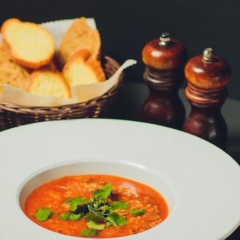 Bowl of fresh italian style minestrone soup against