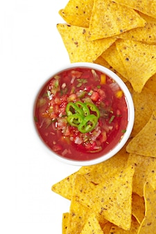 Bowl of fresh salsa dip isolated