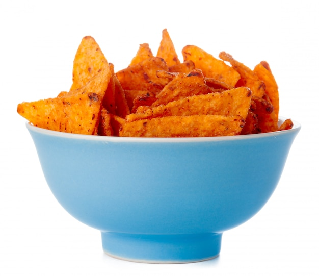 Bowl full of nachos chips isolated on white