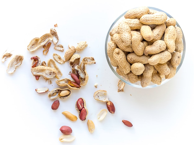 A bowl full of peanuts from above
