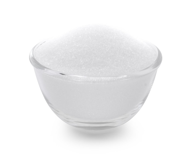 Bowl glass of sugar isolated on white background.