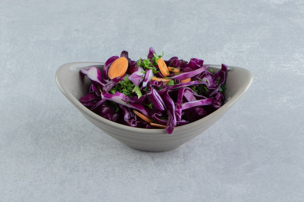 A bowl of grated vegetables, on the marble.