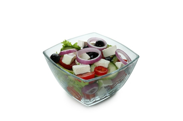 Bowl of greek salad isolated on white surface