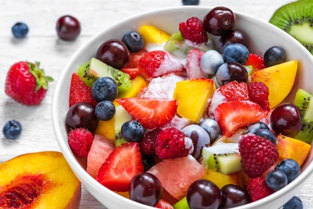 Bowl of healthy fresh fruit salad with yogurt. healthy vegan food. diet concept