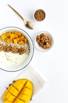 Bowl of homemade granola with yogurt and cereals