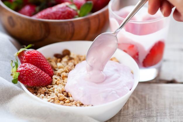 A bowl of homemade granola with yogurt.