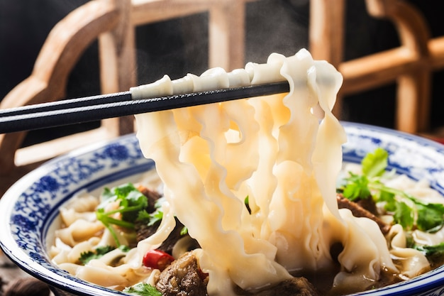 A bowl of noodles with braised beef