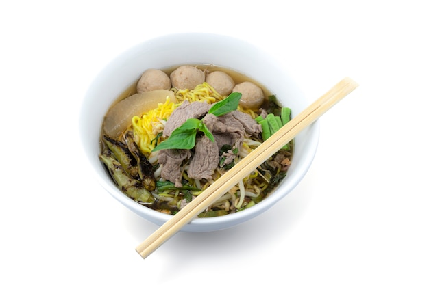 Bowl of noodles with meatballs and boiled beef isolated on white with clipping path
