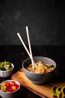 Bowl of noodles with shrimp and copy space