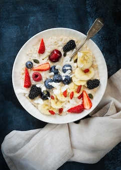 Bowl of oatmeal porridge with fruits