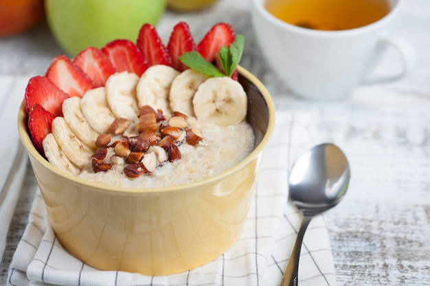 Bowl of oatmeal with a banana.