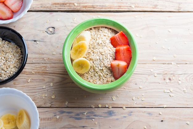 Bowl oats ingredients (oat, banana, strawberry and vegetal milk)