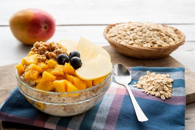 Bowl of porridge with fruit for healthy breakfast