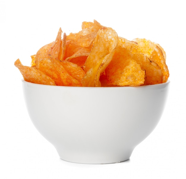 Bowl of  potato chips isolated on white