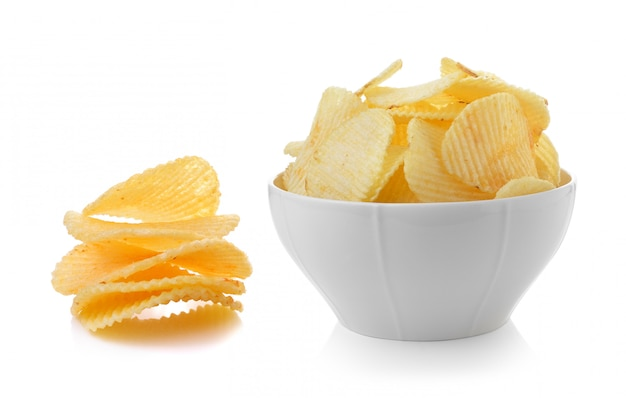 Bowl of potato chips on white background