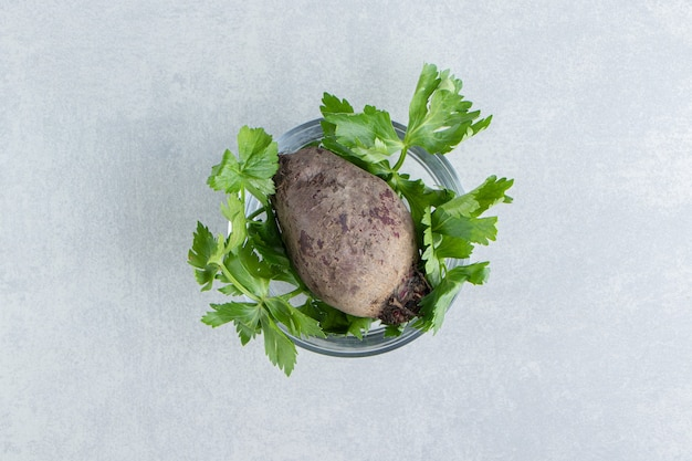 A bowl of radish with parsley , on the marble.