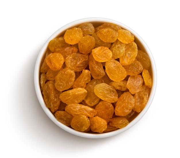 Bowl of raisins isolated on white