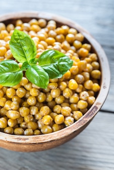 Bowl of roasted chickpeas on the wooden table