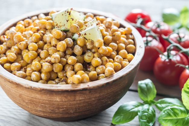 Bowl of roasted chickpeas on wooden