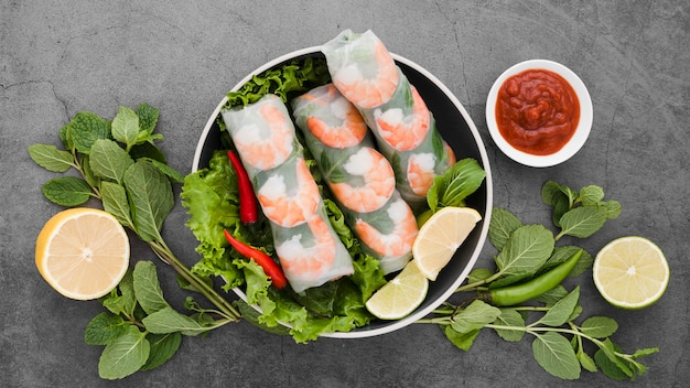Bowl of shrimp rolls with mint and lemon