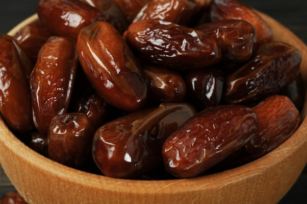 Bowl of tasty dates fruits, close up