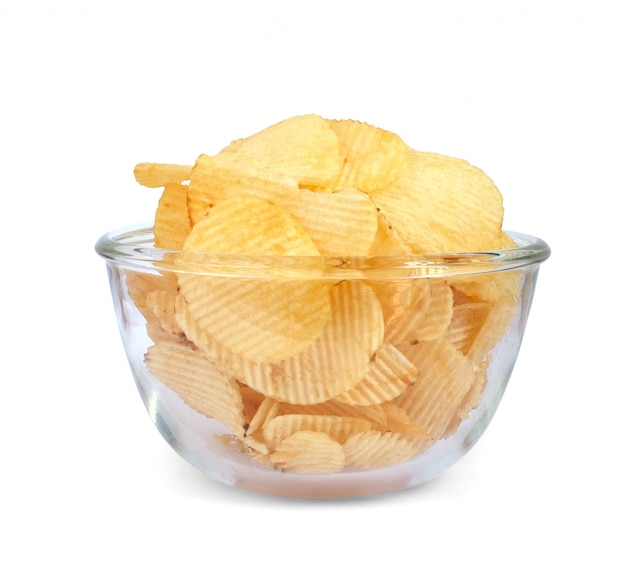 Bowl of tasty ridged potato chips on white background. this has clipping path