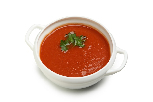 Bowl of tomato soup isolated on white