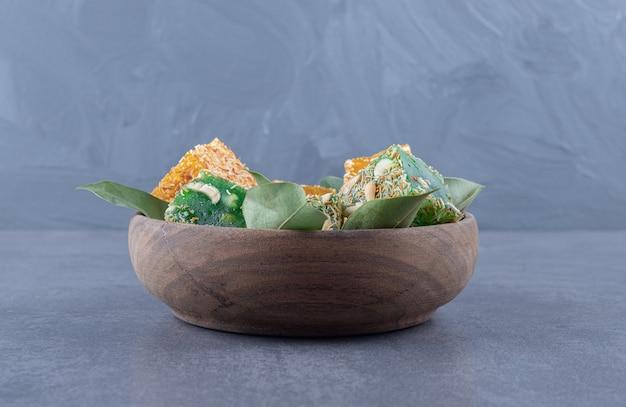 Bowl of turkish delight. lokum or rahat lokum with hazelnuts on grey background.
