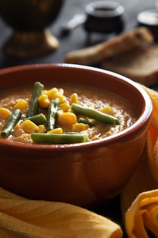 Bowl of vegetable puree soup with beans and corn