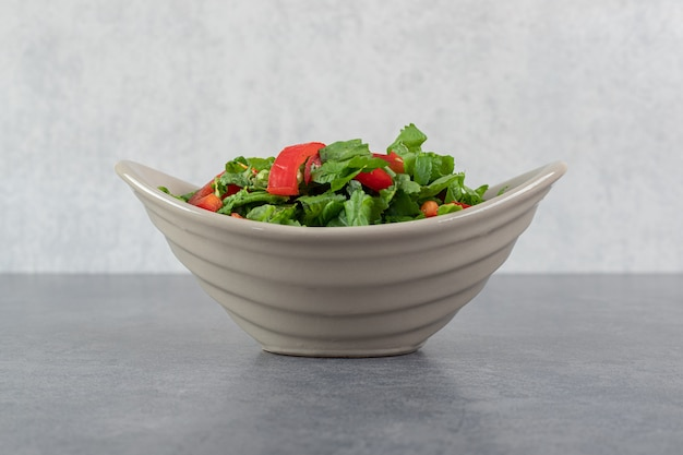 Bowl of vegetable salad on marble background. high quality photo