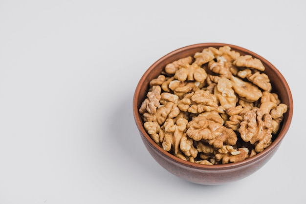 Bowl of walnuts on white