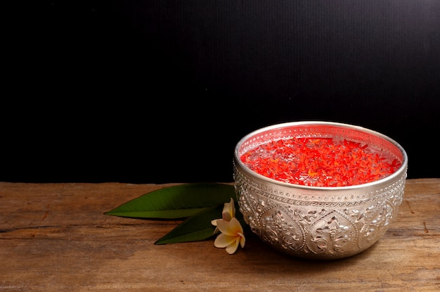 Bowl of water and flowers for songkran festival