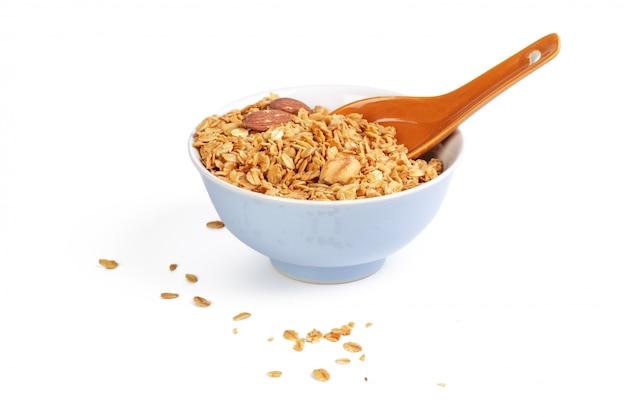 Bowl of whole grain muesli isolated on white background