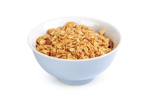 Bowl of whole grain muesli isolated on white