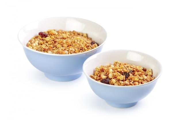 Bowl of whole grain muesli isolated on white