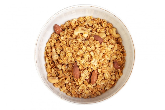 Bowl of whole grain muesli isolated