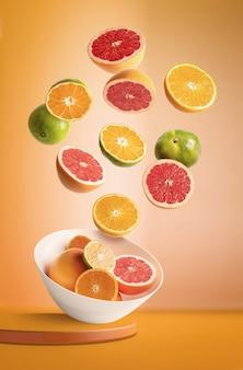 オレンジ色の背景に飛んでいるオレンジとみかんの盛り合わせとボウル