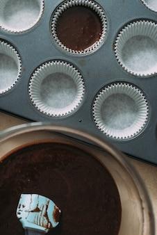 Bowl with batter near muffin tin