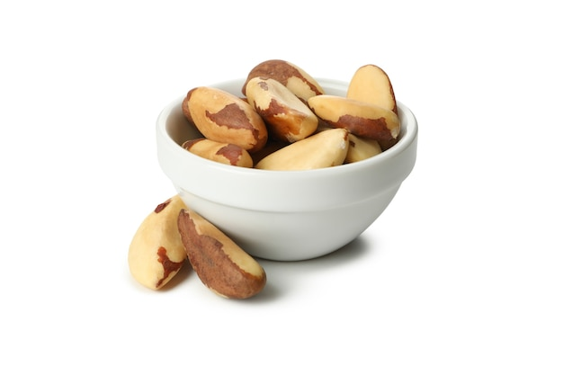 Bowl with brazil nuts isolated on white background