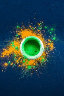 Bowl with bright green powder on table