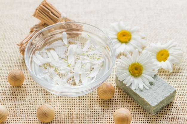 Bowl with camomile petals and camomile