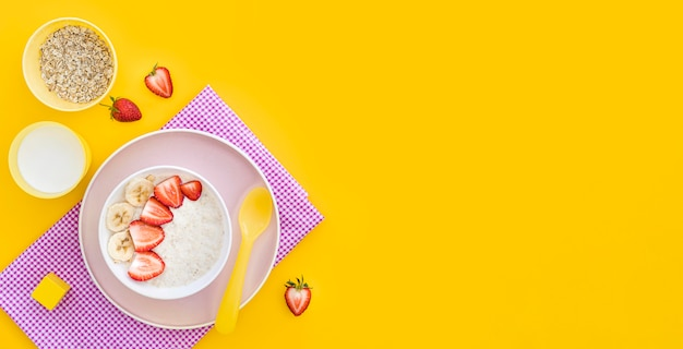 Bowl with cereals and fruits with copy-space
