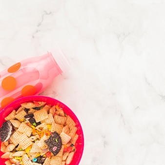 Bowl with cereals and milk bottle